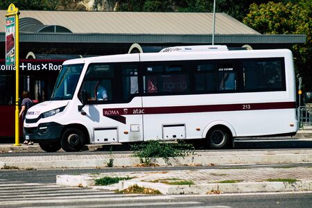 Rome Italy September 15, 2019 View of a white public bus rolling through the streets of Rome in the morning