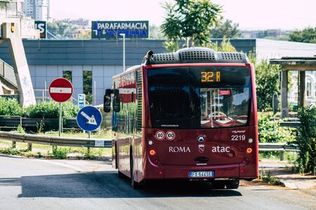 Rome Italy September 15, 2019 View of a red public bus rolling through the streets of Rome in the morning