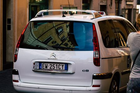 Rome Italy September XX, 2019 View of a traditional Italian taxi rolling through the streets of Rome in the morning