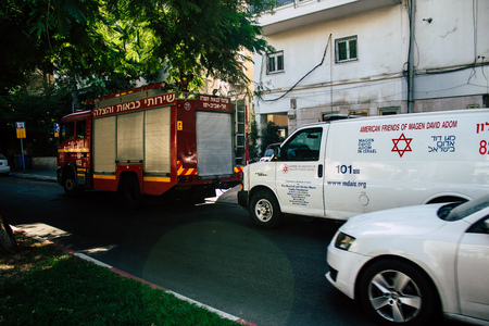 Tel Aviv Israel August 24, 2019 View of Israeli ambulance and fire engine parked in the streets of Tel Aviv in the afternoon