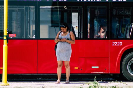Rome Italy September 15, 2019 View of unknown people at the bus stand in Rome in the morning Zdjęcie Seryjne