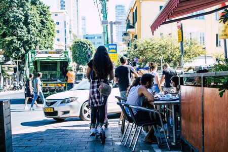 Tel Aviv Israel September 27, 2019 View of unknown Israeli people rolling with a electric in the streets of Tel Aviv in the afternoon
