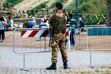Rome Italy September 29, 2019 View of an Italian soldier on protection mission of the Coliseum of Rome in the morning Фото со стока