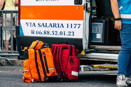 Rome Italy September 29, 2019 View of ambulancier assisting tourists in distress front the Coliseum of Rome in the morning