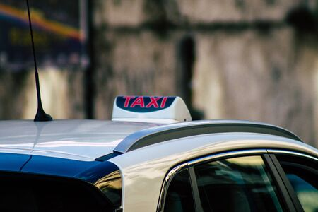 Rome Italy September 29, 2019 View of a traditional Italian taxi rolling through the streets of Rome in the morning