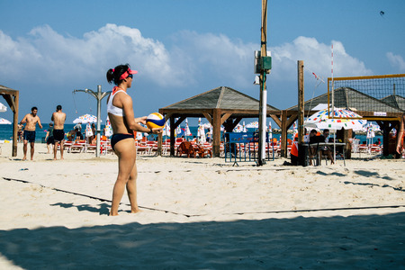 Tel Aviv Israel August 25, 2019 View of unknown Israeli girl playing National Beach volleyball competition at Gordon beach in Tel Aviv Editorial