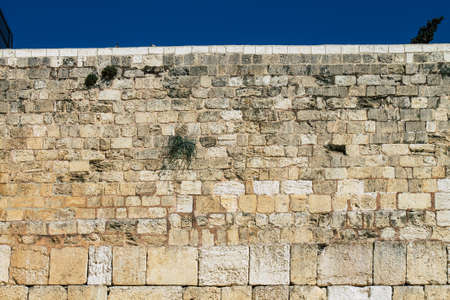 Closeup of the Western wall in the Old city of Jerusalem in the afternoon