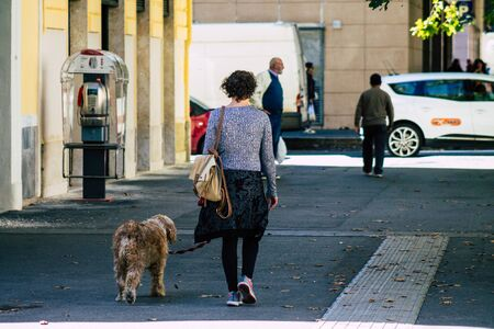 Rome Italy October 18, 2019 View of unknowns people walking in the streets of Rome near the Coliseum in the afternoon