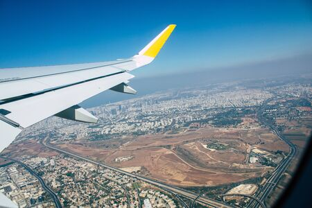 View of a plane flying from Ben Gurion international airport in the afternoon