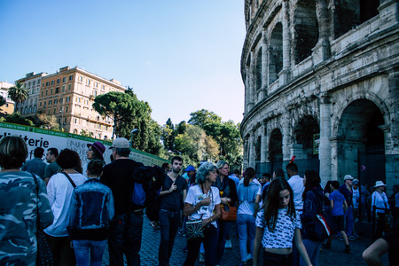 Rome Italy October 18, 2019 View of unknowns people walking in the streets of Rome near the Coliseum in the afternoon Publikacyjne