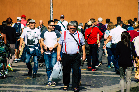 Rome Italy October 18, 2019 View of unknowns people walking in the streets of Rome near Vatican city in the afternoon Publikacyjne