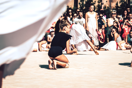 Rome Italy September 29, 2019 Celebrations of the 150th anniversary of the Italian gymnastics federation, public demonstration of young gymnasts in the streets of Rome near the Coliseum Imagens - 133367413