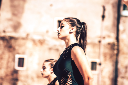 Rome Italy September 29, 2019 Celebrations of the 150th anniversary of the Italian gymnastics federation, public demonstration of young gymnasts in the streets of Rome near the Coliseum Imagens - 133367423