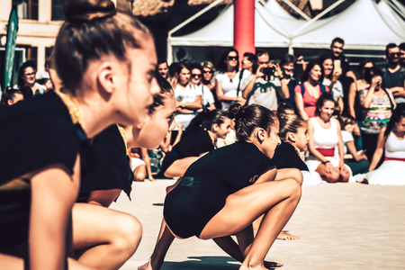 Rome Italy September 29, 2019 Celebrations of the 150th anniversary of the Italian gymnastics federation, public demonstration of young gymnasts in the streets of Rome near the Coliseum Imagens - 133367435