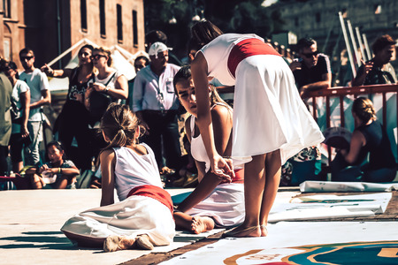 Rome Italy September 29, 2019 Celebrations of the 150th anniversary of the Italian gymnastics federation, public demonstration of young gymnasts in the streets of Rome near the Coliseum Imagens - 133367457