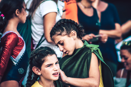 Rome Italy September 29, 2019 Celebrations of the 150th anniversary of the Italian gymnastics federation, public demonstration of young gymnasts in the streets of Rome near the Coliseum Imagens - 133367459