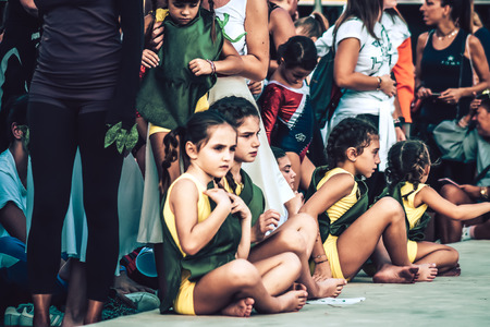 Rome Italy September 29, 2019 Celebrations of the 150th anniversary of the Italian gymnastics federation, public demonstration of young gymnasts in the streets of Rome near the Coliseum Imagens - 133367470