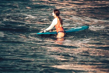 Tel Aviv Israel October 07, 2019 View of unknown Israeli people practicing surfing on Tel Aviv beach in the morning