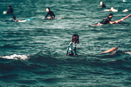 Tel Aviv Israel October 07, 2019 View of unknown Israeli people practicing surfing on Tel Aviv beach in the morning Editöryel