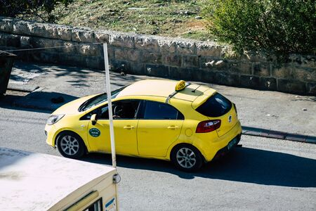 Palestinian Territory Bethlehem December 16, 2019 View of yellow Palestinian taxi rolling in the streets of Bethlehem in the afternoon