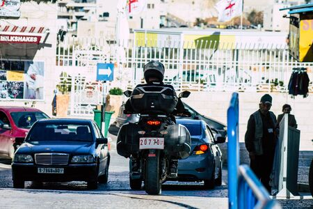 Palestinian Territory Bethlehem December 16, 2019 View of a Palestinian police officer with a motorcycle rolling in the streets of Bethlehem in the afternoon