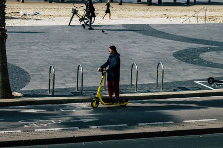 Tel Aviv Israel December 31, 2019 View of unidentified people rolling with an electric scooter in the streets of Tel Aviv in the afternoon
