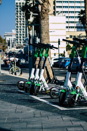 Tel Aviv Israel January 11, 2020 View of a Lime brand electric scooter parked in the streets of Tel Aviv in winter Banque d'images - 137770008