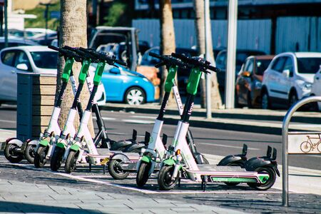 Tel Aviv Israel January 11, 2020 View of a Lime brand electric scooter parked in the streets of Tel Aviv in winter Banque d'images - 137771489