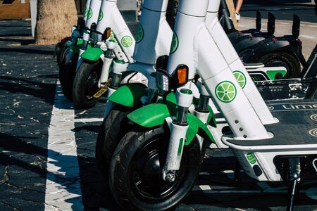 Tel Aviv Israel January 11, 2020 View of a Lime brand electric scooter parked in the streets of Tel Aviv in winter Banque d'images - 137774474