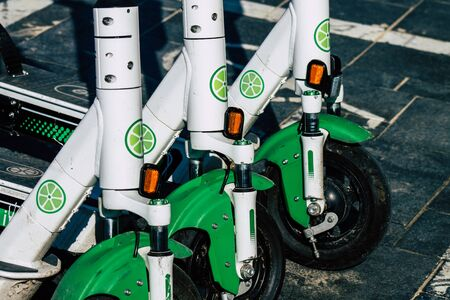 Tel Aviv Israel January 11, 2020 View of a Lime brand electric scooter parked in the streets of Tel Aviv in winter Banque d'images - 137775215