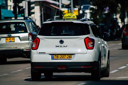 Tel Aviv Israel January 13, 2020 View of traditional Israeli taxi rolling in the streets of Tel Aviv in the afternoon