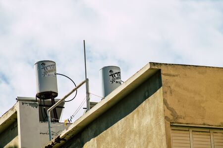 Tel Aviv Israel January 23, 2020 View of a solar water heater on the roof of a Tel Aviv building in the afternoon Stockfoto