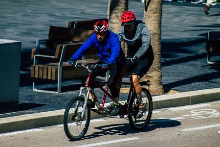 Tel Aviv Israel February 12, 2020 View of unidentified people rolling with a bicycle in the streets of Tel Aviv during a sunny day in winter