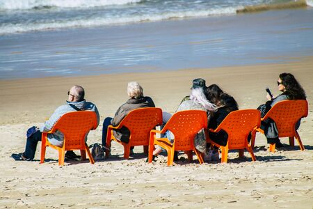 Tel Aviv Israel February 12, 2020 View of unidentified Israeli people having fun on the beach of Tel Aviv during a sunny day in winter