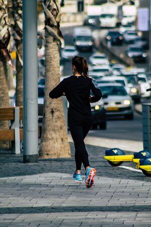 Tel Aviv Israel February 12, 2020 View of unidentified people running on Herbert Samuel Promenade in Tel Aviv during a sunny day in winter