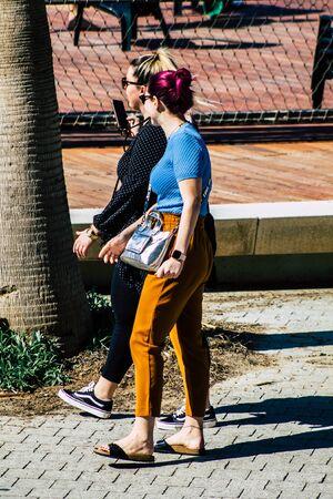 Tel Aviv Israel February 13, 2020 View of unidentified people walking on Herbert Samuel Promenade in Tel Aviv during a sunny day in winter Stock fotó