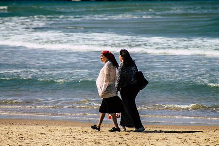 Tel Aviv Israel February 13, 2020 View of unidentified Israeli people having fun on the beach of Tel Aviv during a sunny day in winter
