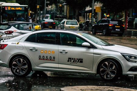 Tel Aviv Israel February 19, 2020 View of traditional Israeli taxi rolling in the streets of Tel Aviv during a raining day in winter