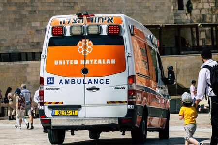 Jerusalem Israel July 3, 2019 View of a Israeli ambulance rolling front the Western Wall in the Old city of Jerusalem in the afternoon