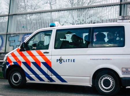 Rotterdam Netherlands March 18, 2019 View of a Dutch police car rolling in the highway in the afternoon