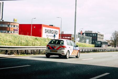 Rotterdam Netherlands March 18, 2019 View of a Dutch police car rolling in the highway in the afternoon Stock Photo