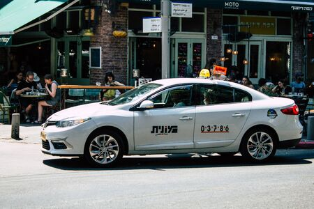 Tel Aviv Israel July 30, 2019 View of traditional Israeli taxi rolling in the streets of Tel Aviv in the afternoon Stock fotó