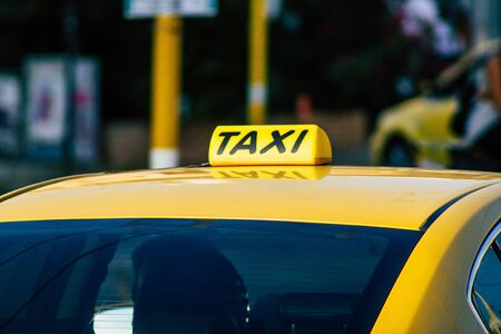 Athens Greece September 7, 2019 View of Greek yellow taxi driving through the streets of Athens in the morning