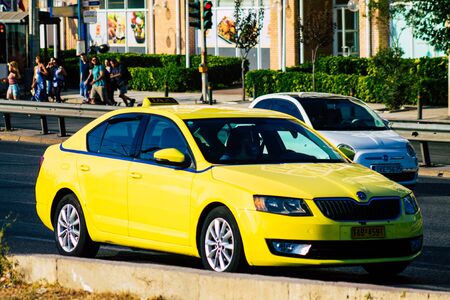 Athens Greece September 7, 2019 View of Greek yellow taxi driving through the streets of Athens in the morning Stock Photo