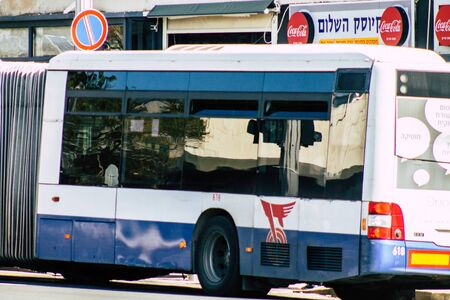 Tel Aviv Israel January 31, 2020 View of a traditional Israeli public city bus rolling in the streets of Tel Aviv in in the afternoon