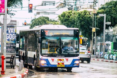 Tel Aviv Israel February 19, 2020 View of a traditional Israeli public city bus rolling in the streets of Tel Aviv during a raining day in winter Stock fotó