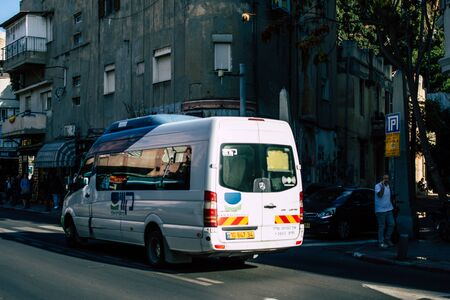 Tel Aviv Israel December 02, 2019 View of a traditional Israeli public city bus rolling in the streets of Tel Aviv in in the afternoon Archivio Fotografico