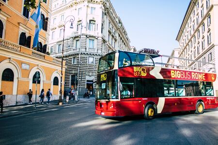 Rome Italy October 20, 2019 View of a tourist bus rolling through the streets of Rome in the evening