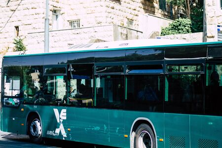 Jerusalem Israel June 24, 2019 View of traditional city bus rolling in the streets of Jerusalem in the afternoon