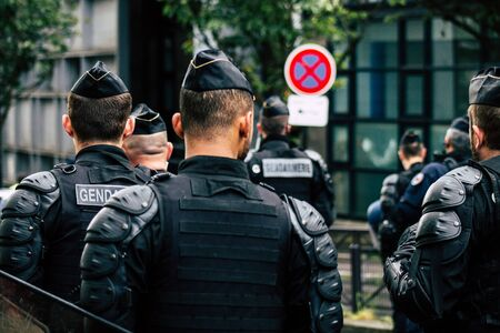 Paris France May 04, 2019 View of a riot squad of the French National Gendarmerie in intervention during protests of the Yellow Jackets against the policy of President Macron in Paris on saturday afternoon Banque d'images - 148172524